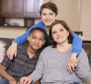Multi-ethnic, adoption or foster care family at home.
